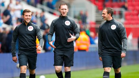 Referee Simon Mather warms up with his officials before the National League Play-off Final Match bet