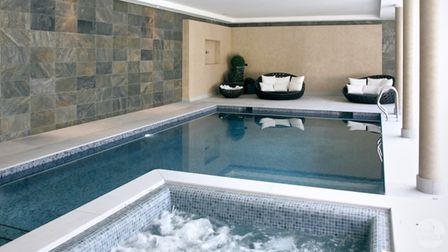 Limestone indoor swimming pool crafted by stoneCIRCLE in Basingstoke