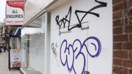 Graffiti on the empty shop, formerly Evans, in Red Lion Street. Picture: DENISE BRADLEY