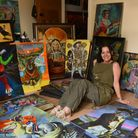 Artist Sue Clyne with just a few of the stacks of her paintings she has created during Lockdown at h