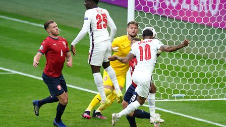 England's Raheem Sterling (right) scores their side's first goal of the game during the UEFA Euro 20