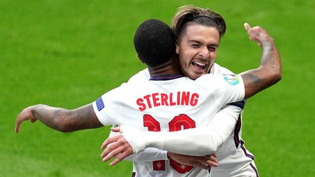 England's Raheem Sterling (left) celebrates scoring their side's first goal of the game with Jack Gr