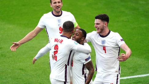 England's Raheem Sterling (centre) celebrates scoring their side's first goal of the game with Kyle
