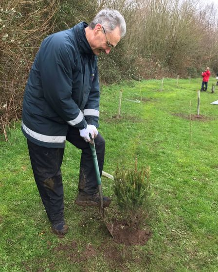 Cllr Don Davies helped to plant treesat Watchhouse Hill in February 2020.