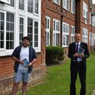 Author Nic Williamson, left, back at King's School in Ottery with headteacher Rob Gammon