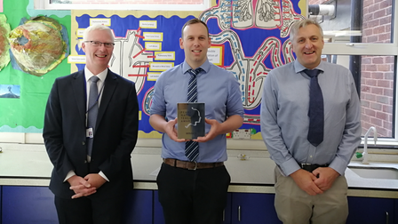 Rob Thorp, centre,was presented with his silver National Teaching Awardby Hitchin Boys' head Fergal Moane, left