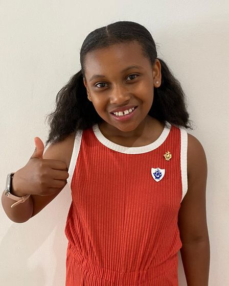 Nahla-Rose proudly wears her gold Blue Peter badge.