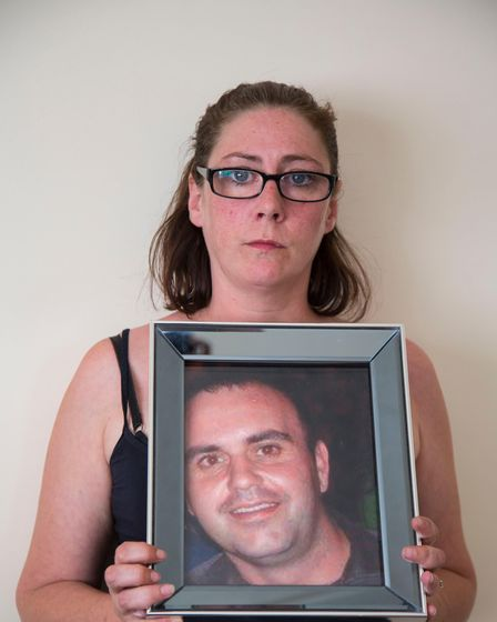 Melissa Cottier with a picture of Richard Cottier