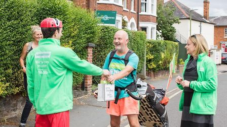 Fancy Dress Dad Nick Jemetta from Hitchin greets David Matthews, who has walked over 4,400 miles so for Samaritans