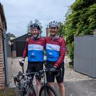 Two men in cycling gear and helmets