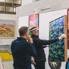 People looking at artworks at Sussex Art Fairs