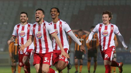 Stevenage players celebrate victory in the penalty shoot-out against Hull City
