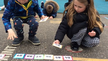 Tillie and Jonah from Year Two ordering numbers for Dereham Church Infant and Nursery School's 'number day'.