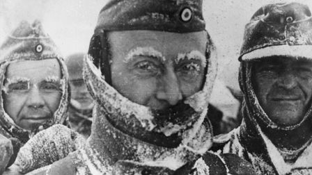 27th March 1944: Three German soldiers covered in snow and ice during winter on the Eastern front.