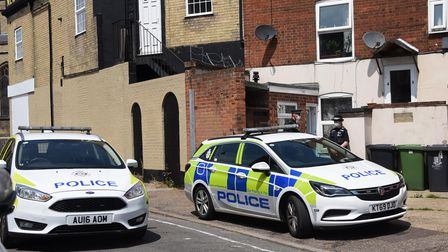 Police at the Victoria Road entrance of a building after reports of an unexploded device inside. Pic