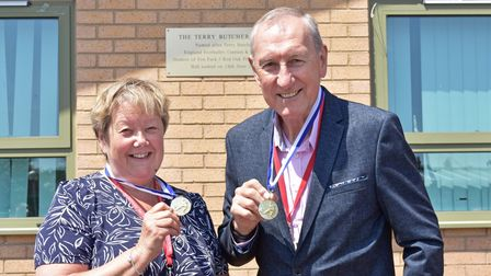 Terry Butcher and sister Vanda were presented with medals on the return to their former school in Lowestoft.