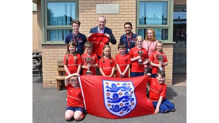 Terry Butcher with staff and pupils at Red Oak Primary School in Lowestoft.