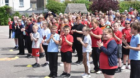 Pupils applauding Terry Butcher at Red Oak Primary School in Lowestoft.
