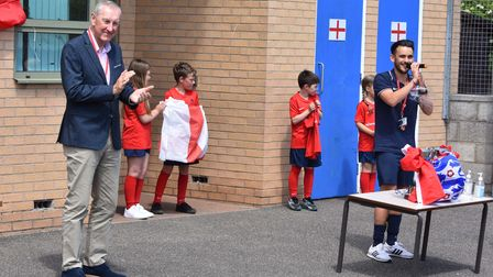 Terry Butcher, Johnny Lee and pupils at the unveiling ofa plaque at the sports hall which has been named after him.