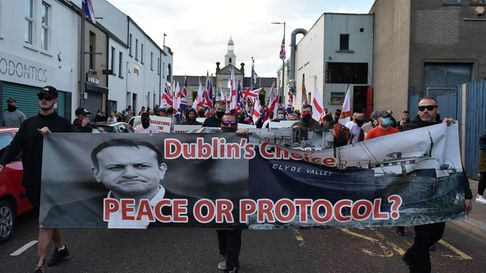 Loyalist band members and supporters make their way through Newtownards town centre following an anti-Protocol protest rally