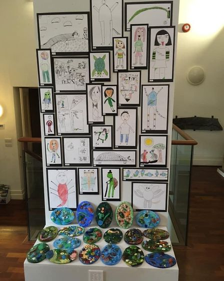 Ceramic pieces and pictures created by local under-11s at the workshops.
