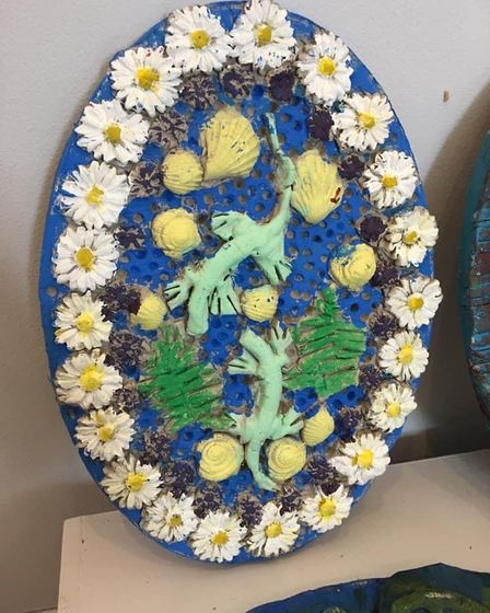 Ceramic plaque made by a schoolchild artist inspired by the Pallisey-style earthenware dish.