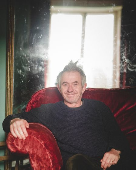 Exeter man Tony Lidington, who runs a local flea circus, pictured in a chair at home.