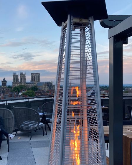 Heaters warm the roof top bar
