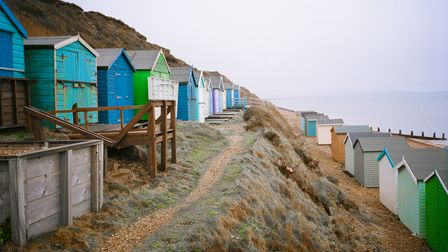 Candy coloured beach huts on Milford on Sea Beach, one of Hampshire's Dog-Friendly Beaches