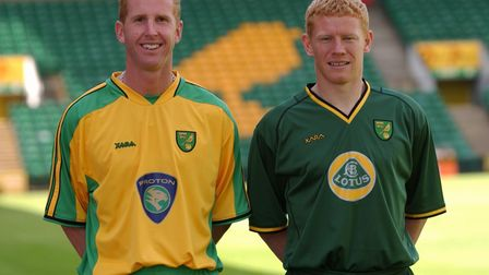 Norwich City players Iwan Roberts and Gary Holt model NCFC kit for 2003 after the announcement that