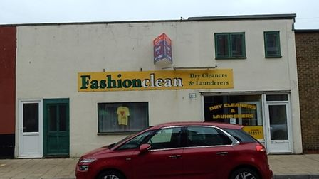 The shop traded as Fashion Clean Dry Cleaners and Launderette for a number of years, but is now vacant.