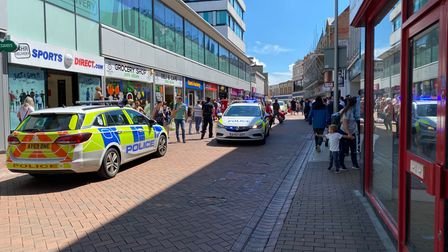 There are three police cars in Ipswich town centre on Carr Street.