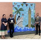 Hayley White, director of assessment for Pearson;student Kayla; and mayor of HaringeyCllr Adam Jogee with HLP's award