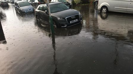 Cars partially submerged after Hornchurch flooding
