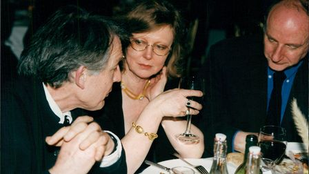 Cate Haste with Piers Plowright and Tristram Powell at a dinner party