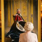 TOPSHOT - Britain's Queen Elizabeth II, views a painting of herself by British artist Henry Ward, at