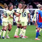 Arsenal's Katie McCabe (second left) celebrates with her team-mates after scoring their side's ninth