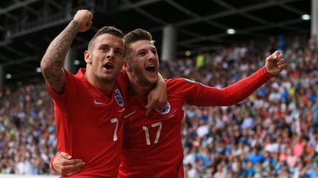 England's Jack Wilshere (left) celebrates with team mate Adam Lallana (right) after scoring his side