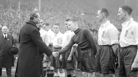 The Duke of Gloucester shaking hands with Harry Hibbs, of England, before the international football