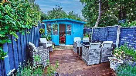 There is a spacious summer house at the bottom of the garden.