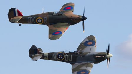 A Spitfire (front) and a Hurricane (back) fly in tandem.