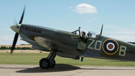 A Spitfire on the airfield at IWM Duxford, along the Flightline Walk