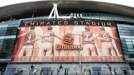 The Emirates Stadium with people queuing out front to get the Covid-19 vaccination