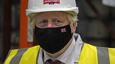 Prime Minister Boris Johnson during a visit to Johnstone's Paints Limited in Batley, West Yorkshire,
