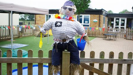A plump scarecrow looks as if he's about to have a day on the beach