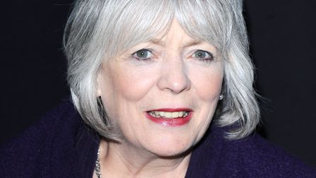 (RED) supporter Alison Steadman stands in front of the London Eye which has been illuminated red to