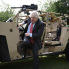 Boris Johnson steps down from an armoured vehicle during a trip to Aldershot garrison on June 24, 2021