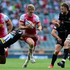 Louis Lynagh of Harlequins is tackled by Tom OÕFlaherty of Exeter Chiefs during the Gallagher Premie