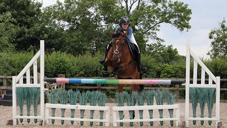 Show jumping demonstrations at Sperrings Equestrian Country Fair.
