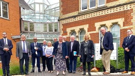 A group of people standing in a doorway: Opposition councillors at Uttlesford